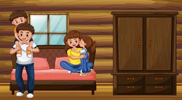 Familj med föräldrar och två barn i sovrummet