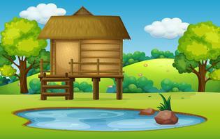 Hütte in der Teichnaturszene vektor