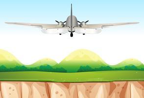 Flugzeug fliegt über die Hügel