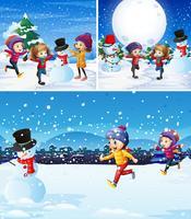 Kinder, die mit Schneemann im Schnee spielen
