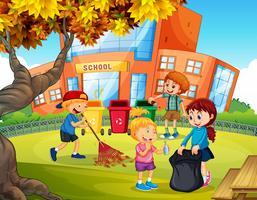Barn volontärarbete städa upp skolan