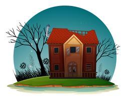 Gammalt hus med trasiga fönster på natten