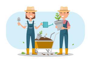 glad pojke och tjej planterar ett träd utomhus