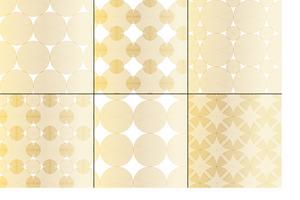 geometrische Muster aus metallischem Gold und weißen konzentrischen Kreisen
