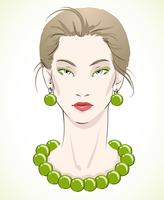 Elegant unga modellporträtt med gröna pärlor