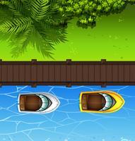 Zwei Boote schwimmen in der Nähe der Brücke vektor