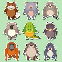 Klistermärke design för vilda djur på grön bakgrund vektor