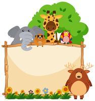 Träram med vilda djur i trädgården vektor