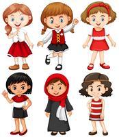 Flickor i röda och svarta kostymer