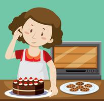 Kvinna bakar tårta och kakor