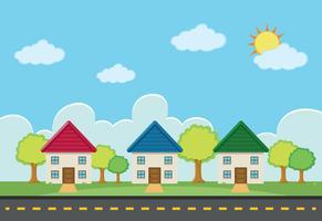 Scen med tre hus längs vägen
