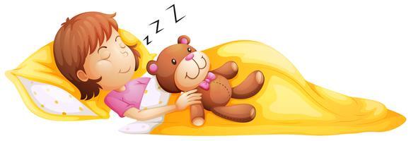 En ung tjej som sover med sin leksak