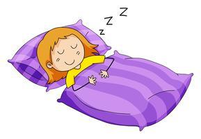 Liten tjej som sover i sängen