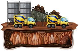 Gruvlandskap och gul lastbil
