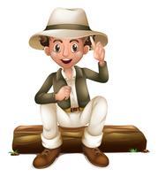 Man i safari outfit sitter på loggen