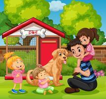 Fader och tre tjejer med hund i trädgården