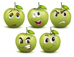 Grüne Äpfel mit verschiedenen Emotionen