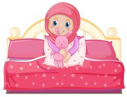 En muslimsk tjej på sängen