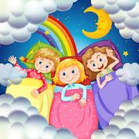 Tre tjejer i sängen på natten