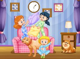 Tre tjejer och två hundar i vardagsrummet