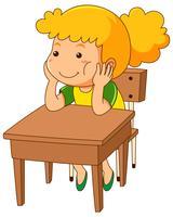Tjej sitter på trä skrivbord