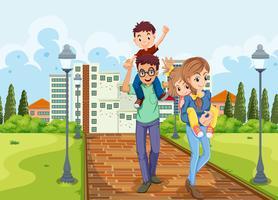 Familj ta en promenad i parken