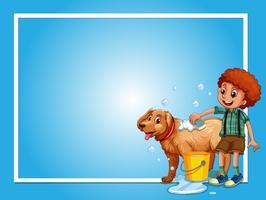 Gränsmall med pojke tvätt hund