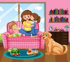 Mor och två barn med husdjurshund i vardagsrummet