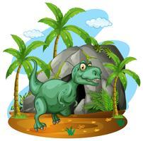 Grön dinosaur som står vid grottan