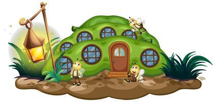 Greenpea-Haus mit Bienen im Garten vektor