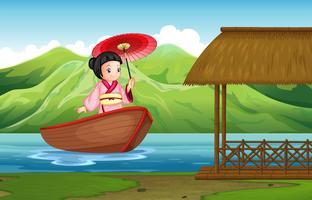 Traditionell japansk tjej i naturen