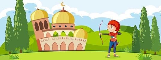 En muslimsk bågskytte traning framför moskén