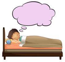 En ung pojke med en tom tanke medan han sov