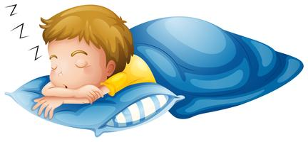 En liten pojke sover