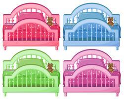 Fyra färgglada sängar