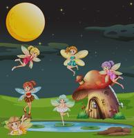 Fairies som flyger över huset på natten