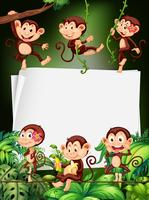 Border design med apor i skogen vektor