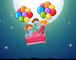 Tre tjejer i sängen flyger med ballonger