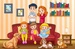 Familj med tre tjejer och hundar i vardagsrummet