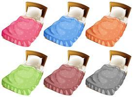 Betten mit sechs verschiedenen Farbdecken vektor