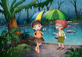 Pojke och tjej är i regnet