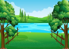 Scen med sjö och fält vektor