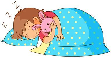 Liten tjej sover med kanin docka