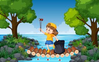 Ein Mädchen sammeln Müll in der Natur