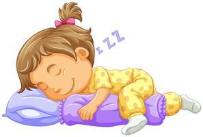 Tjejbarn sover på blå kudde
