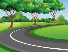Scen med väg i parken