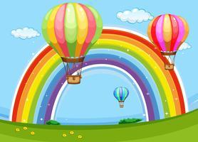 Färgglada ballonger som flyger över regnbågen