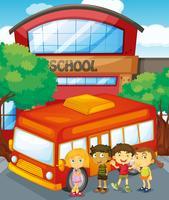 Barn står vid skolbuss i skolan