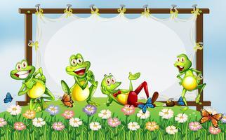 Ramdesign med gröna grodor i trädgården