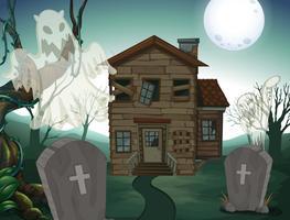 Haunted hus och kyrkogård på natten